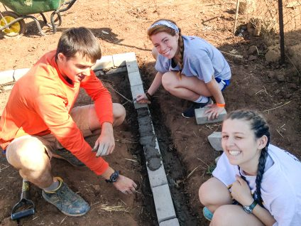 students from bold earth doing community service