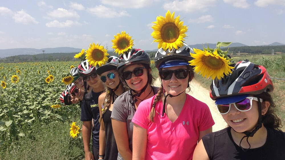 Biking Trip in Hawaii Stopping to Pose in Sunflower Field
