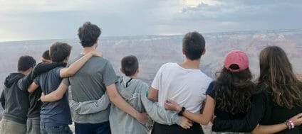 teens in front of a canyon