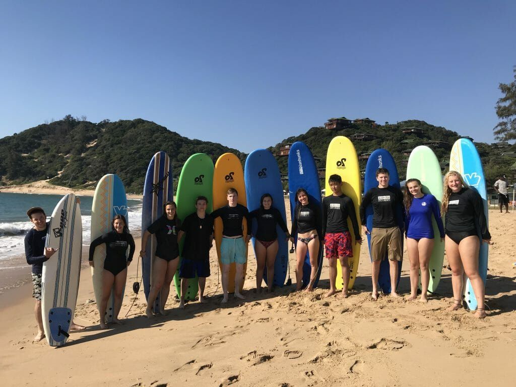 teens with surfboards in Africa